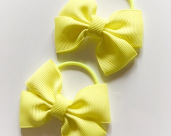Pair of neon/bright yellow bobbles - pigtail bobbles, hair bows, hair elastics