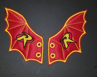 Bat with robin logo shoe wings in the hoop machine embroidery design