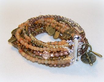 MULTI STRAND BRACELET ...  lovely shades of brown and peach