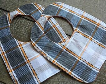 Orange and grey plaid flannel bib