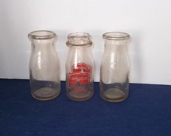 3 Vintage 40s / 50s Embossed/Pain Half-Painted Milk Bottles-2 Plain-1 Carnation