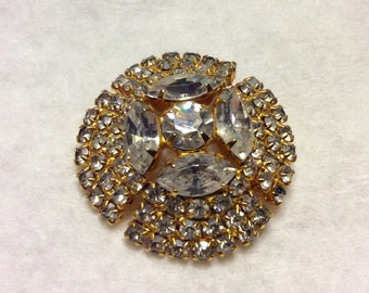 Vintage gold metal clear colorless rhinestones circle brooch pin.