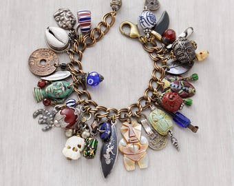 """Exotic Travels Charm Bracelet -  tribal masks, coins, gems, beads, sterling silver - vintage charms on solid brass chain 7"""" to 8.5"""""""
