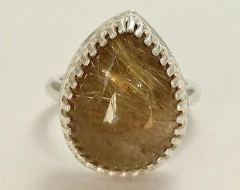 Sterling silver handmade pear shaped golden rutilated quartz ring, hallmarked in Edinburgh.