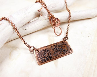 Copper postal necklace.