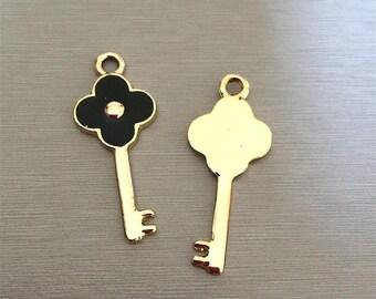 key: Gold black enamel