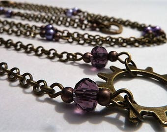 Set of two chains with purple pearls and crystals and a steampunk sunburst cog