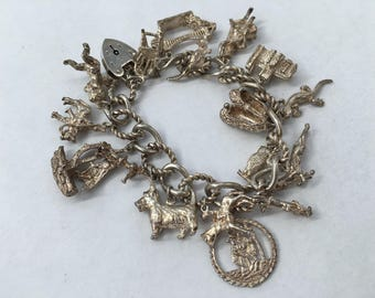 Complete Charm Bracelet with 17 Charms . Vintage, Sterling Silver. Hallmarked 1977. Gifts for Her. Weight 75.7 g.