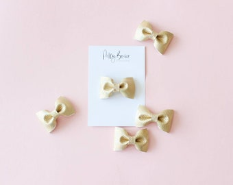 Faux leather bow   pale gold