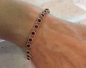 Avon bracelet with red stones