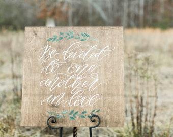 Romans 12:10 Sign