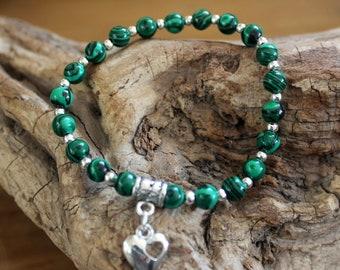 Lovely bracelet with semi precious Malachite beads and heart charm.