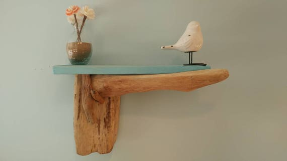 Handmade hanging wall shelf with cedar top shelf and driftwood accents.