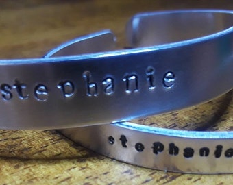 custom hand stamped name cuffs. 2 band sizes available. aluminum