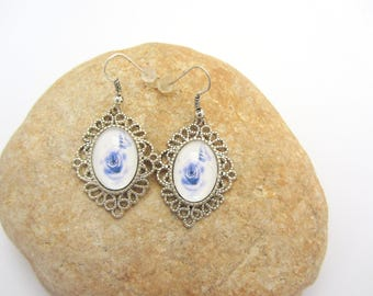 Butterfly glass cabochon oval earrings blue and white