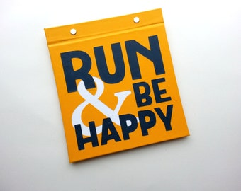 Running Bib Holder - Run and Be Happy - Gifts for Runners - Hand-Bound Race Bib Book Gold and Navy