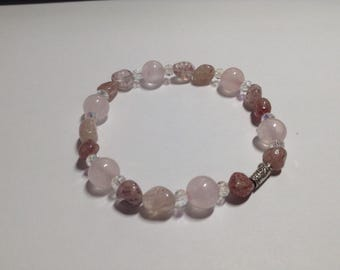 Love Glow. Leprocrocite  and rose quartz beads with crystals and karen hill tribe silver bracelet.