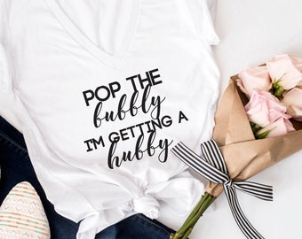 Pop the bubbly i'm getting a hubby, Pop the bubbly shirt. Bride T-shirt. Bride Shirt. bachelorette tshirt. Bride to be Gift. Bride tshirt
