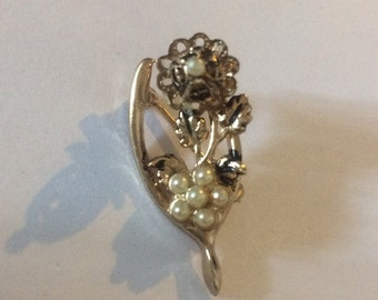Vintage silver coloured wishbone and flower brooch. Faux pearl petals. Gift idea for her
