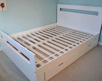 Queen bed with a lovely large storage drawer