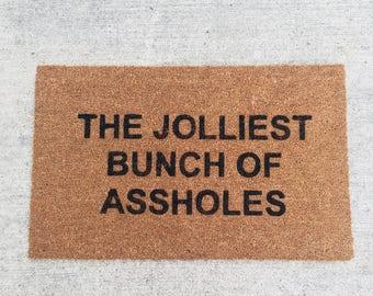 The jolliest bunch of assholes painted custom doormat