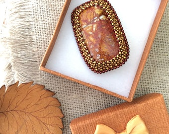 Brown brooch of jasper magnificent natural pattern minimum trim beads warm colors are a perfect gift
