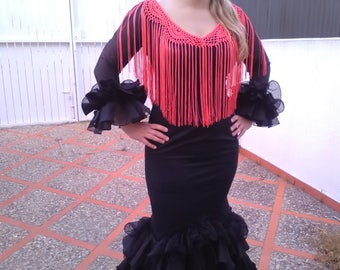 Flamenco fringes, made with Cuquillo thread, you can use it with CUA, any dress or blouse that will give you a chic touch.