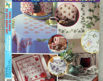 Hands and cross - stitch wonders year to embroider