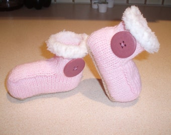 """Hand knitted pink booties trimmed with """"Ugg"""" button - range of sizes to fit 0-12 months"""