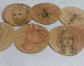 7 Assorted Stamped Disc Tags