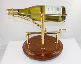Mechanical wine/port decanting cradle goldplated