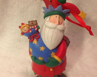 Christmas Santa A different kind whimiscial about 6 inches tall made by hand