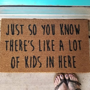 A lot of kids in here doormat  funny welcome mat parents gift grandparents gift daycare gift babysitter gift nanny gift