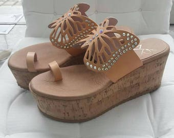 Butterfly leather wedges