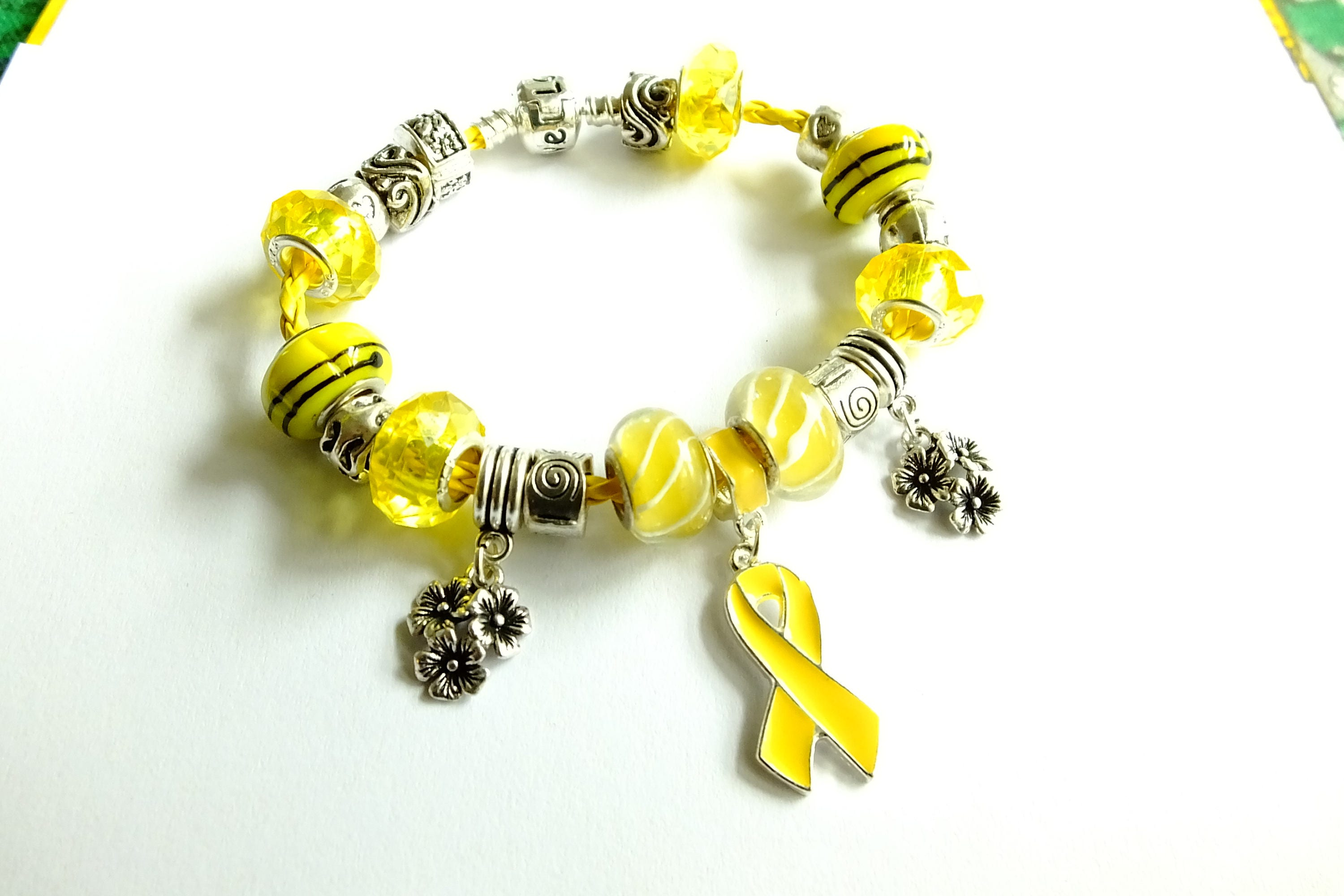 bifida gift by pin endometriosis adenosarcoma bracelet lung liver ribbon charm spina lotus white elephant yellow survivor eye osteosarcoma bladder hamsa awareness cancer