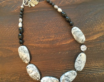 Grey jasper stone with silver Druzy accent and black onyx
