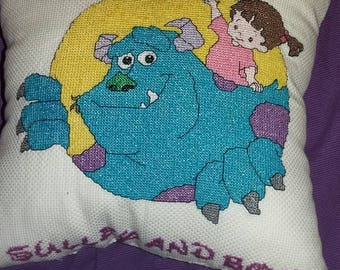 Disney's sulley and boo cross stitch cushion