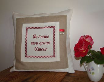 Pillow cover with cross stitch embroidery on white canvas