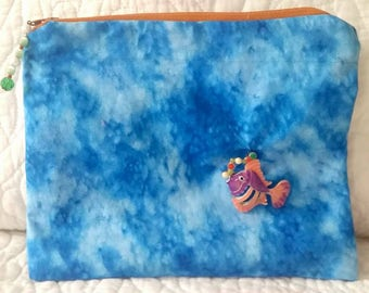 Water print bag with fish charm decoration
