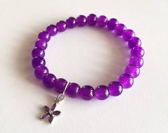 Bracelet perles en verre violet transparentes