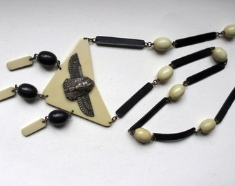 1920s Art deco Egyptian revival celluloid necklace with brass figure of  King Tut Tutankhamun