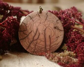 raku pendant, large 7.5 cm ceramic bead, round, slightly rounded, soft pink enamel and black lines, double-sided raku bead