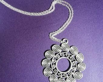 Labyrinth swirl pendant.