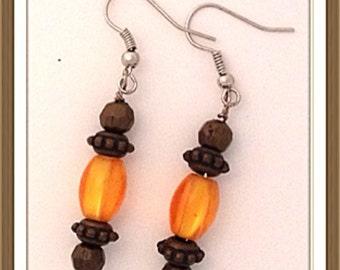 Handmade MWL orange and brown dangle earrings. 0078