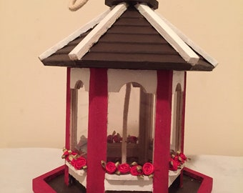Hand painted and crafted red and white bird feeder