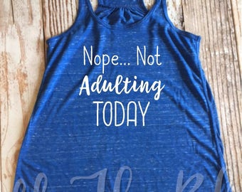 Nope.. Not Adulting Today Ladies Flowy Racerback Tank