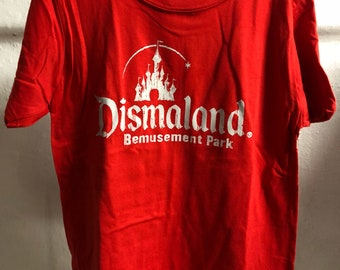 Child M (7-8 years) - Red : Banksy - Dismaland T-Shirt (1070)
