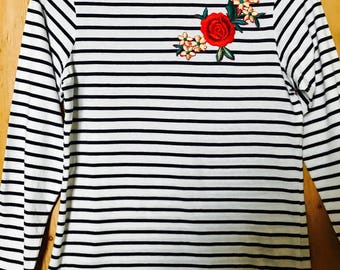 Women's striped long sleeved t-shirt with floral embroidered patch