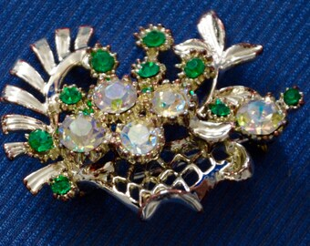 Early Basket of flowers brooch, circa 1950's emeral green stones with diamond shaped rhinestones. Weight 13.3 grams