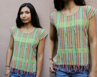 Woven striped rainbow colored tank top with fringe and tassels
